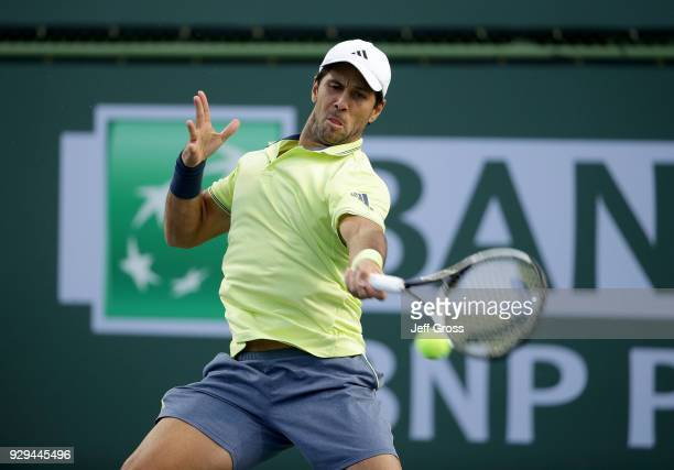 Fernando Verdasco of Spain returns a forehand to Guido Pella of Argentina during the BNP Paribas Open at the Indian Wells Tennis Garden on March 8...