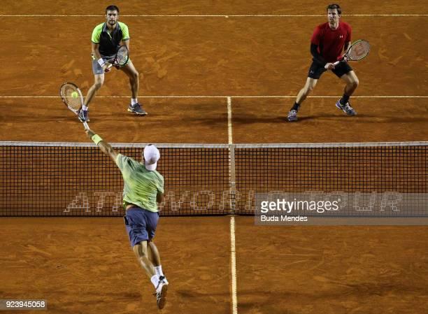 Fernando Verdasco of Spain returns a shot to Alexander Peya of Austria and Nikola Mektic of Croatia during the doubles final of the ATP Rio Open 2018...
