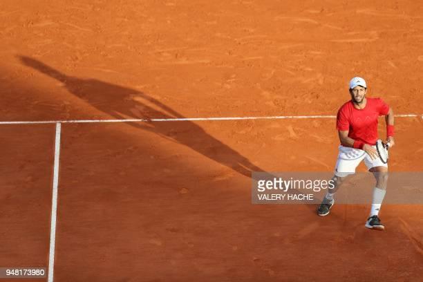 Fernando Verdasco of Spain returns the ball to Marin Cilic of Croatia during the MonteCarlo ATP Masters Series Tournament on April 18 2018 in Monaco...