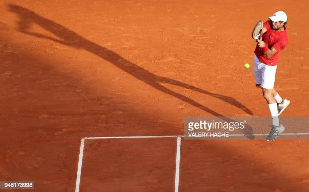 TOPSHOT Fernando Verdasco of Spain returns the ball to Marin Cilic of Croatia during the MonteCarlo ATP Masters Series Tournament on April 18 2018 in...