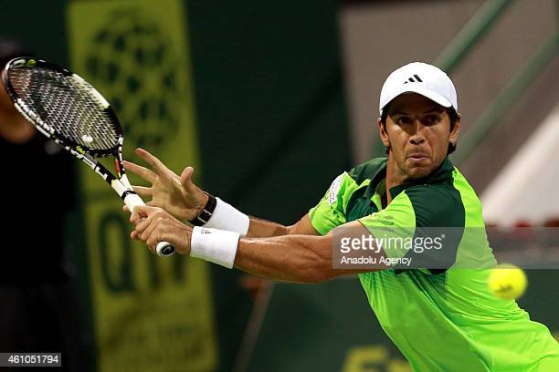 Fernando Verdasco of Spain returns the ball to Russian tennis player Teymuraz Gabashvili during their tennis match in the Qatar's ExxonMobil Open at...