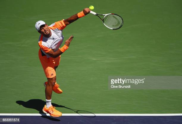 Fernando Verdasco of Spain serves against Rafael Nadal of Spain in their third round match during day nine of the BNP Paribas Open at Indian Wells...