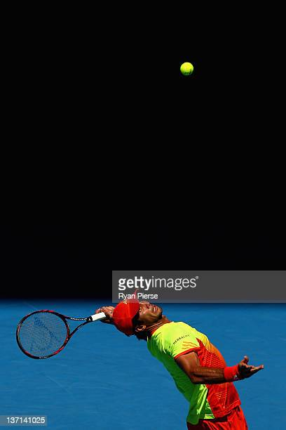 Fernando Verdasco of Spain serves in his first round match against Bernard Tomic of Australia during day one of the 2012 Australian Open at Melbourne...
