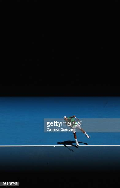 Fernando Verdasco of Spain serves in his fourth round match against Nikolay Davydenko of Russia during day eight of the 2010 Australian Open at...