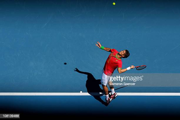 Fernando Verdasco of Spain serves in his second round match against Janko Tipsarevic of Serbia during day three of the 2011 Australian Open at...