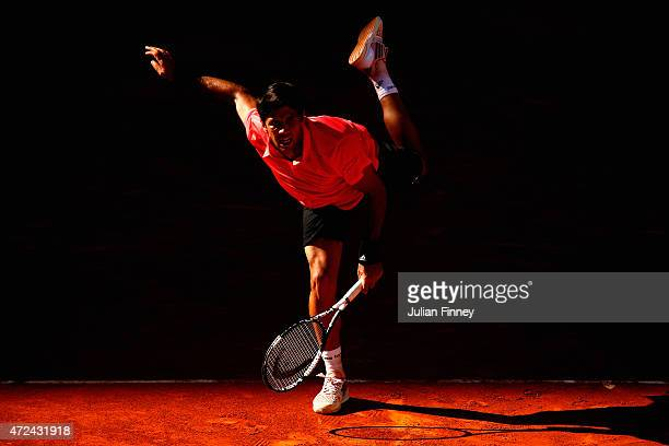 Fernando Verdasco of Spain serves to David Ferrer of Spain during day six of the Mutua Madrid Open tennis tournament at the Caja Magica on May 7 2015...