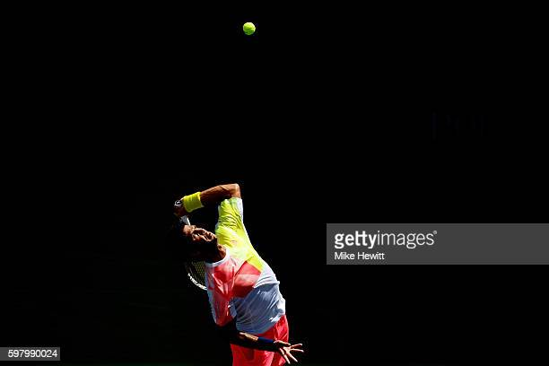Fernando Verdasco of Spain serves to Stan Wawrinka of Switzerland during his first round Men's Singles match on Day Two of the 2016 US Open at the...