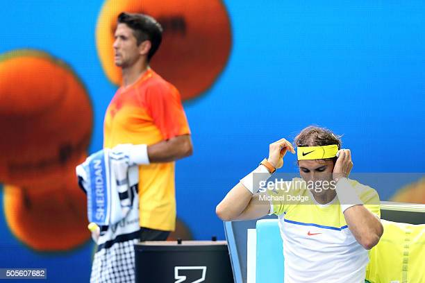 Fernando Verdasco of Spain walks behind Rafael Nadal of Spain in between the change of ends in their first round match during day two of the 2016...