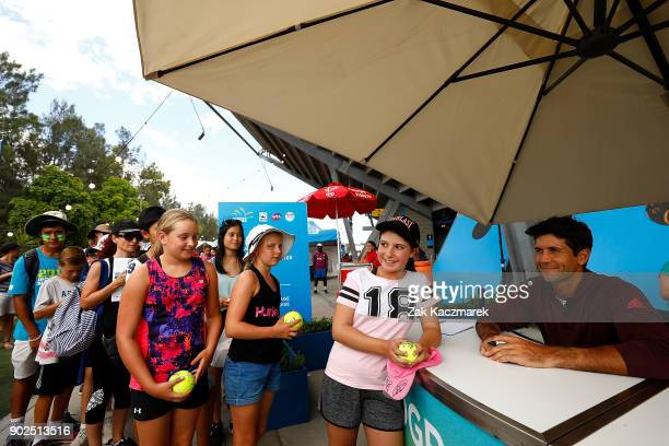 Fernando Verrasco of Spain sign autographs with fans during day two of the 2018 Sydney International at Sydney Olympic Park Tennis Centre on January...