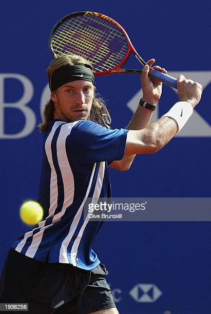 Fernando Vicenete of Spain plays a backhand against Alberto Martin of Spain during the third round of the Tennis Masters at The Monte Carlo Country...
