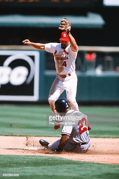 Fernando Vina of the St Louis Cardinals fields against Julio Franco during the game against the Atlanta Braves at Busch Stadium on May 4 2002 in St...