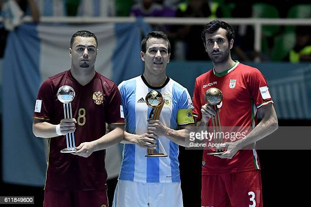 Fernando Wilhelm of Argentina Eder Lima of Russia and Ahmad Esmaeilpour of Iran pose with their awards during the final events of 2016 FIFA Futsal...
