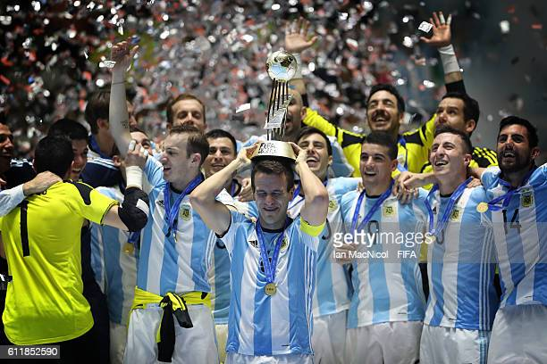 Fernando Wilhelm of Argentina holds the trophy during the FIFA Futsal World Cup Final match between Russia and Argentina at the Coliseo el Pueblo...
