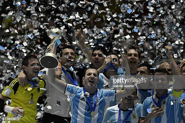 CALI COLOMBIA OCTOBER 01 Fernando Wilhelm of Argentina lifts the winners trophy during the FIFA Futsal World Cup Final match between Russia and...