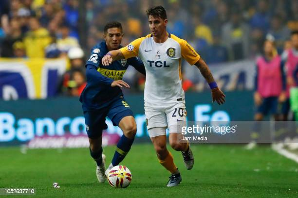 Fernando Zampedri of Rosario Central fights for the ball with Agustin Almendra de Boca Juniors during a match between Boca Juniors and Rosario...