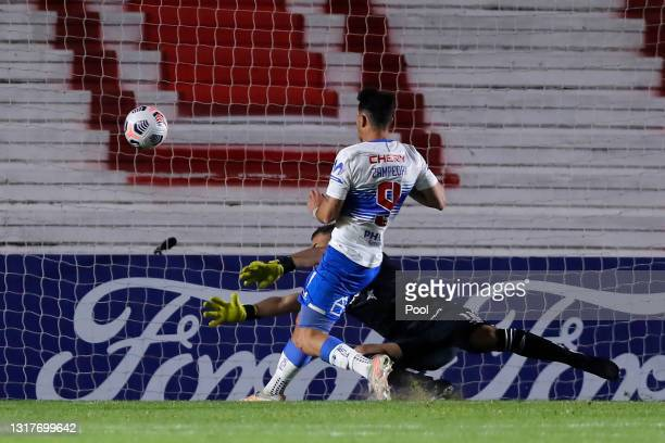 Fernando Zampedri of Universidad Catolica scores the opening goal during a match between Argentinos Juniors and Universidad Católica as part of group...