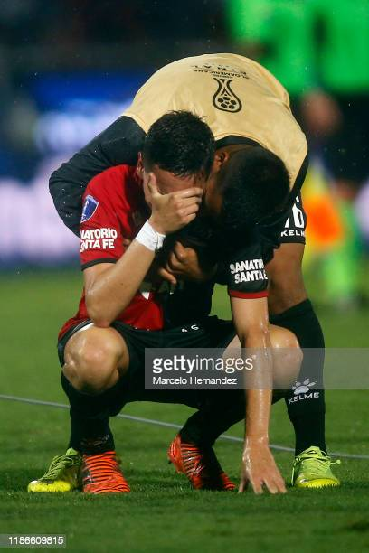 Fernando Zuqui of Colon is comforted by teammate Franco Quiroz after losing the final of Copa CONMEBOL Sudamericana 2019 between Colon and...
