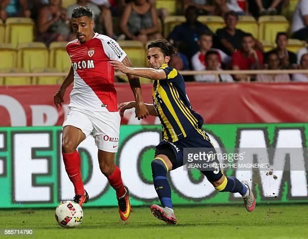 Fernerbahce's mildfielder Ertugrul Taskiran vies with Monaco's French forward Nabil Dirar during the Champions League third qualifying football match...