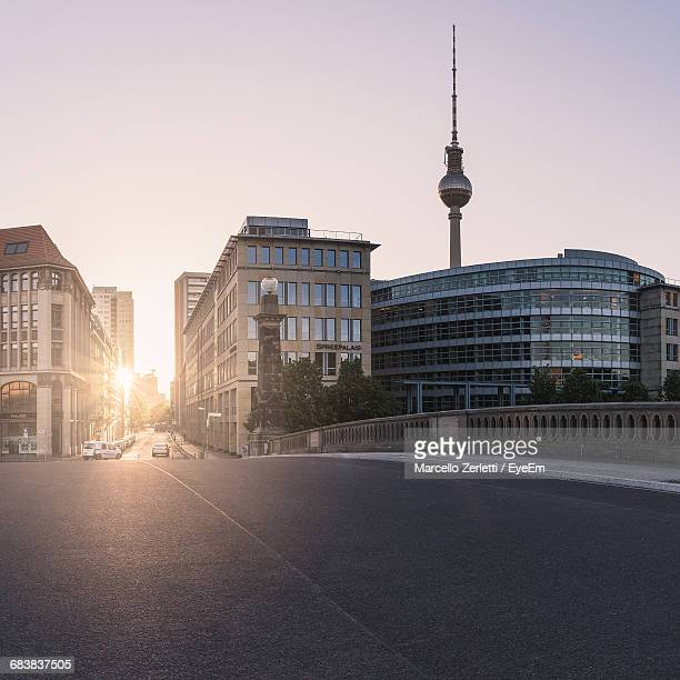 fernsehturm and buildings against clear sky during sunset - television tower berlin stock pictures, royalty-free photos & images