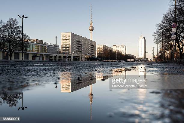 fernsehturm and buildings against clear sky - puddle stock pictures, royalty-free photos & images