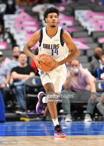 Feron Hunt of the Dallas Mavericks dribbles the ball during a preseason game against the LA Clippers on October 8, 2021 at the American Airlines...