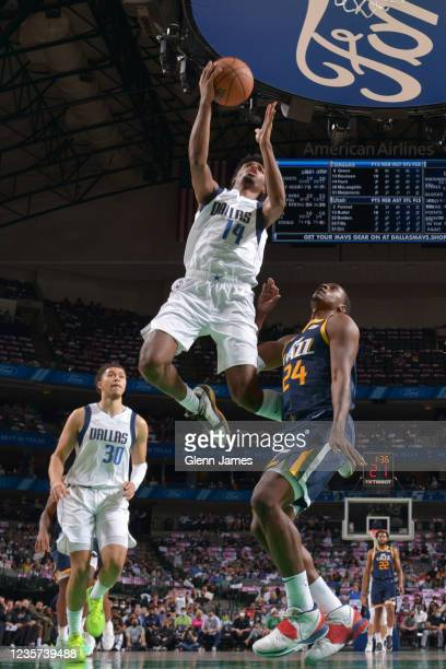 Feron Hunt of the Dallas Mavericks drives to the basket during a preseason game against the Utah Jazz on October 6, 2021 at the American Airlines...