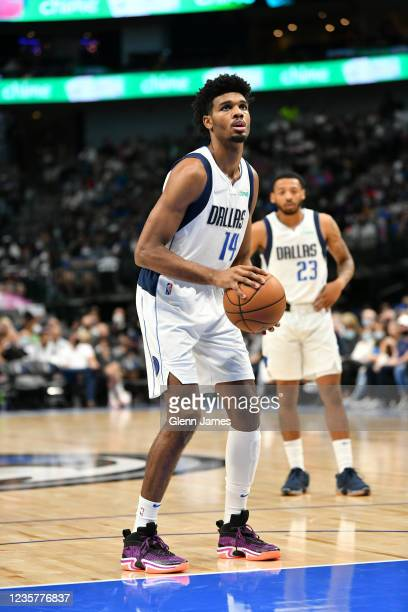 Feron Hunt of the Dallas Mavericks looks on during a preseason game against the LA Clippers on October 8, 2021 at the American Airlines Center in...