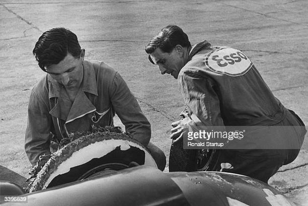 Ferrari mechanics changing a tyre on a racing car at Monza Grand Prix racing circuit Italy Original Publication Picture Post 6740 Monza 1953...