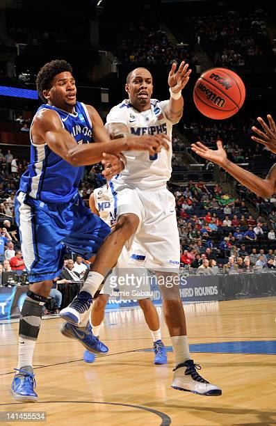 Ferrakohn Hall of the Memphis Tigers fights for a loose ball with Dwayne Evans of the Saint Louis Billikens in the first half during the second round...