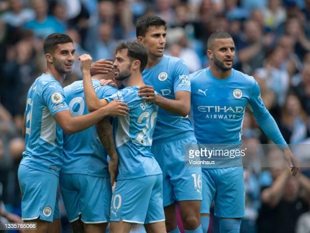 Ferran Torres, Gabriel Jesus, Bernardo Silva, Rodri and Kyle Walker of Manchester City celebrate their teams first goal during the Premier League...