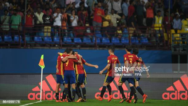 Ferran Torres is mobbed by team mates after scoring during the FIFA U17 World Cup India 2017 Quarter Final match between Spain and Iran at the...