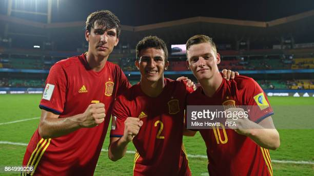 Ferran Torres Mateu Jaume and Sergio Gomez of Spain celebrate after the FIFA U17 World Cup India 2017 Quarter Final match between Spain and Iran at...