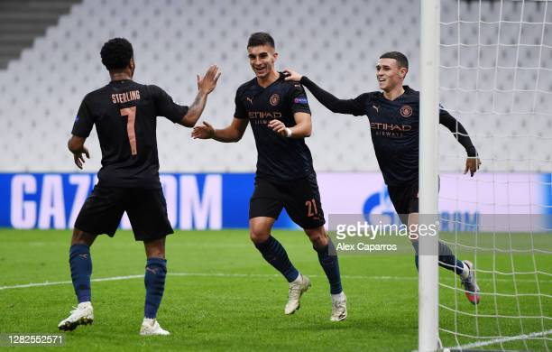 Ferran Torres of Manchester City celebrates after scoring his team's first goal with Raheem Sterling of Manchester City and Phil Foden of Manchester...