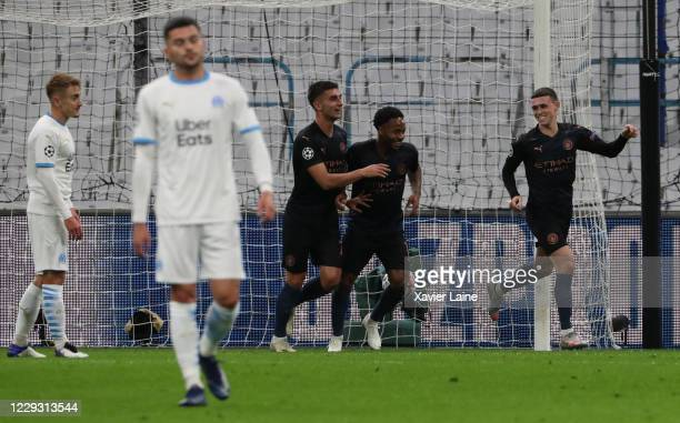 Ferran Torres of Manchester City celebrates his goal with teammates during the UEFA Champions League Group C stage match between Olympique de...