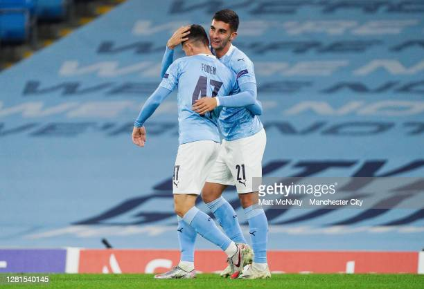 Ferran Torres of Manchester City celebrates with Phil Foden after scoring his teams third goal during the UEFA Champions League Group C stage match...