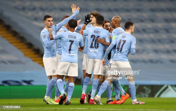 Ferran Torres of Manchester City celebrates with Raheem Sterling and teammates after scoring their team's first goal during the UEFA Champions League...