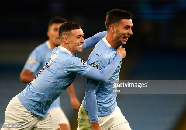 Ferran Torres of Manchester City celebrates with teammate Phil Foden after scoring his sides third goal during the UEFA Champions League Group C...