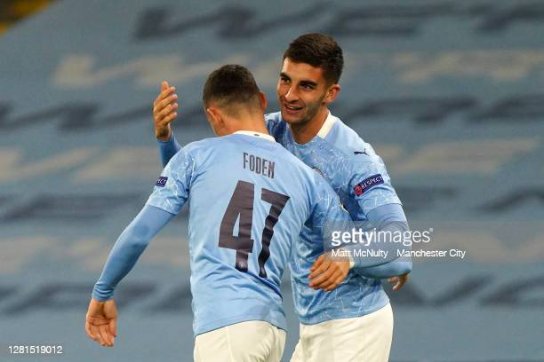 Ferran Torres of Manchester City celebrates with teammate Phil Foden after scoring his team's third goal during the UEFA Champions League Group C...