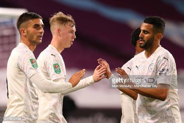 Ferran Torres of Manchester City celebrates with teammates after scoring his sides third goal during the Carabao Cup fourth round match between...