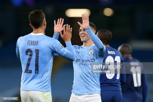 Ferran Torres of Manchester City embraces Phil Foden following the UEFA Champions League Group C stage match between Manchester City and FC Porto at...