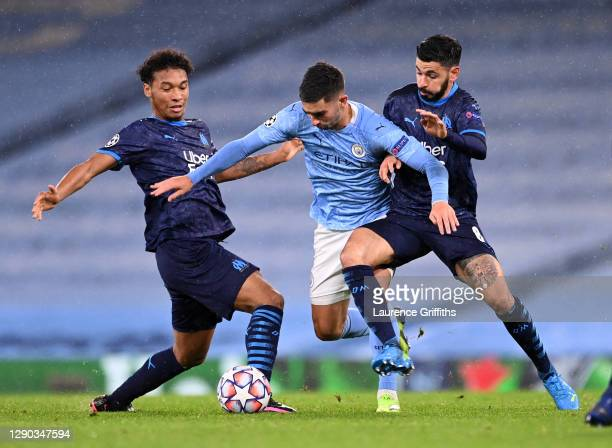 Ferran Torres of Manchester City is challenged by Morgan Sanson and Boubacar Kamara of Olympique de Marseille during the UEFA Champions League Group...