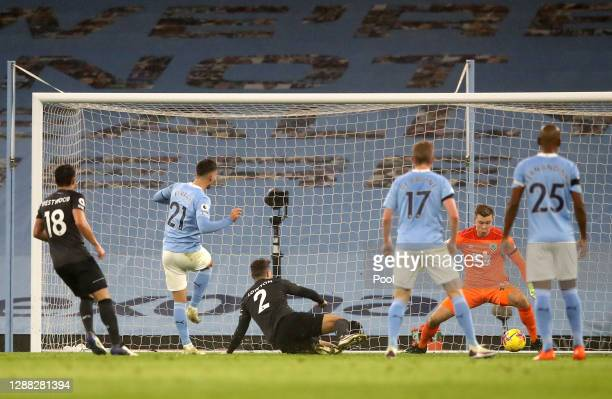 Ferran Torres of Manchester City scores his team's fourth goal during the Premier League match between Manchester City and Burnley at Etihad Stadium...