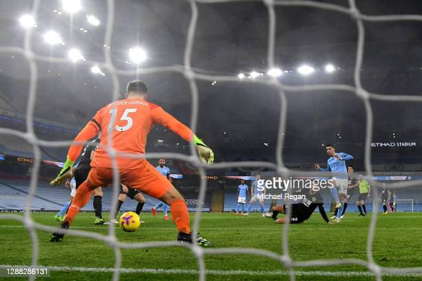 Ferran Torres of Manchester City scores his team's fourth goal past Bailey PeacockFarrell of Burnley during the Premier League match between...