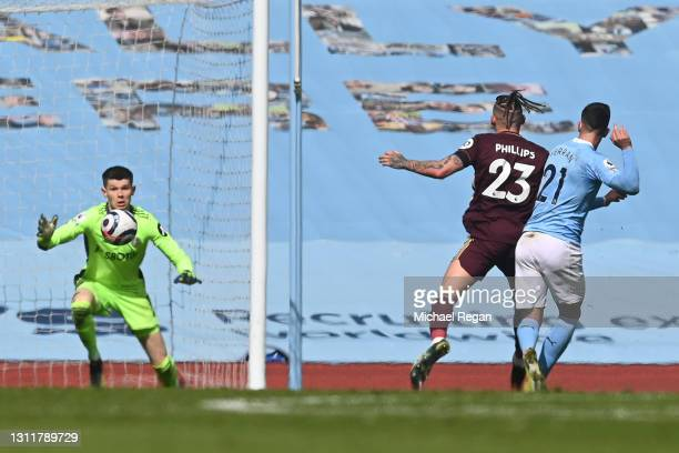 Ferran Torres of Manchester City scores their team's first goal past Illan Meslier under pressure from Kalvin Phillips of Leeds United during the...