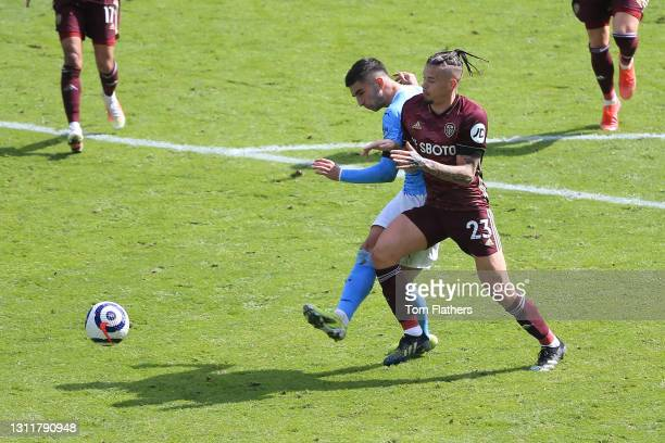 Ferran Torres of Manchester City scores their team's first goal under pressure from Kalvin Phillips of Leeds United during the Premier League match...