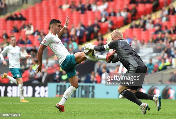 Ferran Torres of Manchester City stretches for the ball whilst under pressure from Kasper Schmeichel of Leicester City during The FA Community Shield...