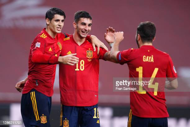 Ferran Torres of Spain celebrates his team's fourth goal with teammates Alvaro Morata and Jose Gaya during the UEFA Nations League group stage match...