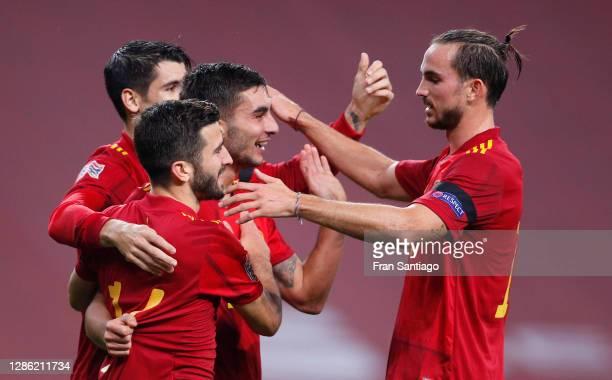 Ferran Torres of Spain celebrates his team's fourth goal with teammates Fabian Ruiz, Alvaro Morata and Jose Gaya during the UEFA Nations League group...
