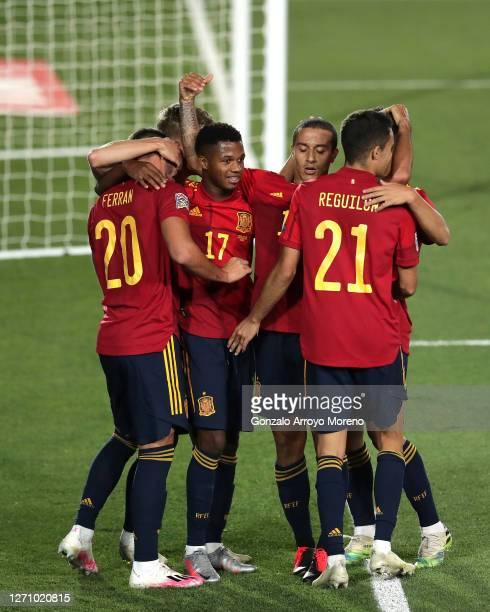 Ferran Torres of Spain celebrates scoring their fourth goal with teammates Ansu Fati , Thiago Alcantara and Sergio Reguilon during the UEFA Nations...