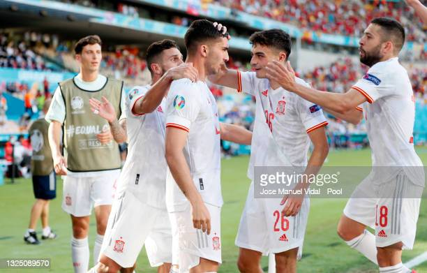 Ferran Torres of Spain celebrates with Pedri and Jordi Alba after scoring their side's fourth goal during the UEFA Euro 2020 Championship Group E...